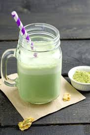 green tea energy drink with matcha powder on table