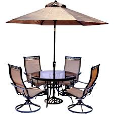 hanover 5 piece aluminum outdoor dining set with round glass top table and contoured