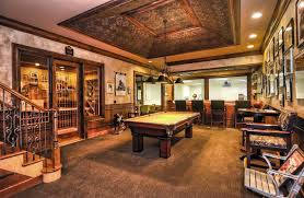 traditional game room with wood bar and wine cellar