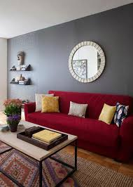 a red couch gives this gray wall a lift and makes a statement in any modern living room