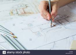 interior design hand drawings. Interior Designer Works On A Hand Drawing Sketch Using Color Pencils, Rule And Rubber Design Drawings N