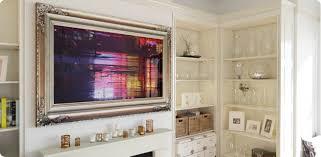 deue framed tv in renaissance frame installed in a living room