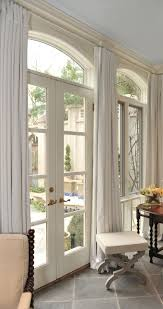 Drapes can hide a less than appealing view but in this case their subtle  color merely. Arched Window CurtainsFrench Door ...