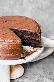 chocolate cake with frosting on a cake platter