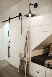 under stairs lighting. basement under stairs nook farmhouse industrial lighting barn doors shiplap white neutrals via linen and flax
