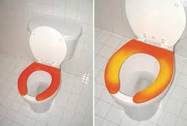 heated toilet seat cover. when i first saw this picture, before read the article, assumed it was a heated toilet seat that changed color to let you know if were about sit cover t