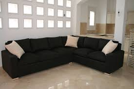 Living Room Black Sofa Furniture Black Sofa With White Cushions In Sparsely Decorated