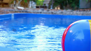 pool water with beach ball. Colorful Beach Ball Thrown Into The Water In Pool Stock Footage Video 10539023   Shutterstock With ,