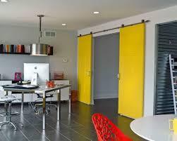 barn doors in an office yellow barn doorodern pulley light fixture