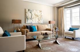 eclectic lviing room in calm brown shades with a couple of bold blue pillows
