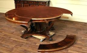 spinning expanding round table spinning expanding table looklikepro wooden expanding table extending wooden dining tables uk