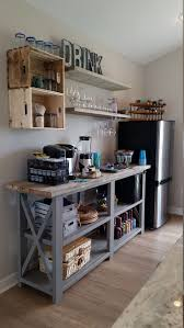 Temporary Kitchen set-up : love this little kitchenette bar area made with  a console plan and shelves! Rustic X beach beverage center