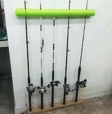 diy fishing rod rack pool noodle and base of reclaimed wood to create a fishing rod diy fishing rod rack