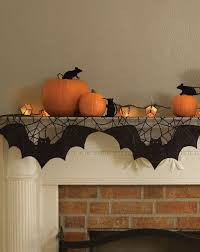 view in gallery simple orange and black decor for a fireplace mantel