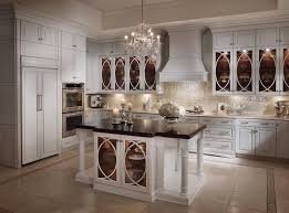 modern country style white kitchen cabinets with pillar four leg table and chandelier
