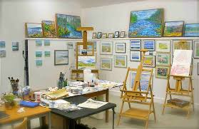 ... attractive home studio with artistic wall paintings also wood crafting  table ...