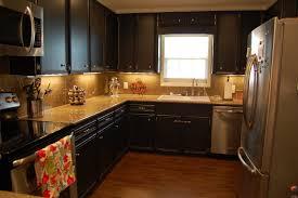 ... Kitchen Black Cabinets With Amazing Lighting And Elegant Floor