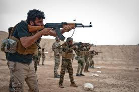 isis a firing line of syrian democratic forces soldiers take aim and fire at targets during a isis main office s45 main