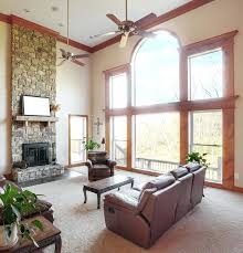 high ceiling fans traditional living room interior with a high ceiling and large windows square format