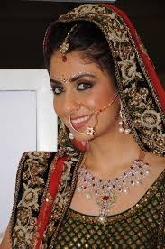 the punjabi bride was given graceful tones of pink and accentuating her delicate femininity silver dusted eyes and blossom pink cheeks gave her a
