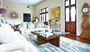 white rug living room eclectic with artwork blue area rug