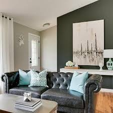 hudson interior designs black leather chesterfield sofa with turquoise pillows