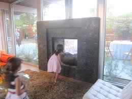 indoor outdoor fireplace see through