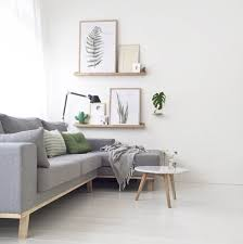 light grey sofa with green touches and botanical decorations