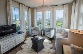 gray velvet chairs with white shelter arm sofa
