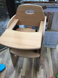 wooden high chair with belt and tray