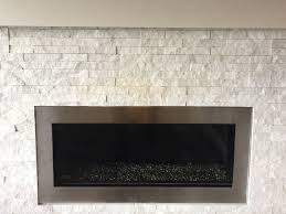 gas exhaust discoloring stacked stone on a fireplace