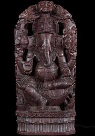 sold wooden ganesh statue with om symbol 24