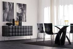 this stylish buffet is shown in a matte black finish on on tufted lacquered wood