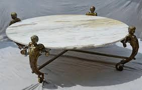 massive brass coffee table with winged cherub legs square brass tubular cross section base with