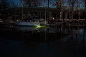 led underwater boat lights and dock lights single lens 60w showing beam pattern off of the stern of a sailboat in white green tint is from mississippi
