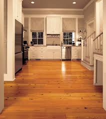 antique reclaimed heart pine solid wood flooring in a contemporary kitchen stainless steel appliances and