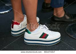 gucci 2017 shoes. milan - june 19: man with white gucci wedge heel sneakers shoes before fendi fashion 2017