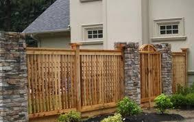 fence design. Fence Design Uses Stone Columns Wooden Panels O