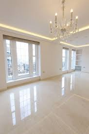 elegant living room with glossy floor tiles with a marble effect tiles from the