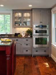 Gray cabinets with a wood floor. Thinking about painting the bathroom cabinets  gray since they will have a cherry floor.