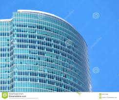 modern office building glass wall top section closeup blue glass top modern office