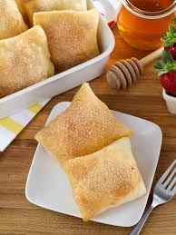 sopapillas fried pastry topped with cinnamon sugar and honey time tested recipe
