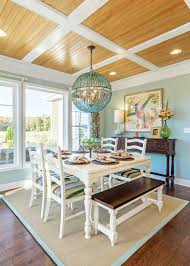 beach house dining eoom with turquoise beaded chandelier on beachy dining room