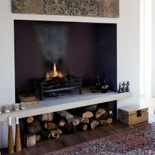 Open Fireplace with logs stored underneath: Fireplace Decorating Ideas