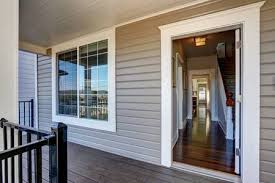 open front door. Empty Covered Porch With Open Front Door And French Window. Northwest, USA  Stock Photo