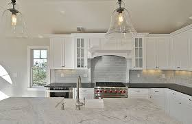 kitchen floor tiles with white cabinets. White Kitchen With Marble Counters And Brick Subway Tile Backsplash Floor Tiles Cabinets