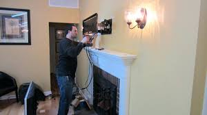 tv mount into stone fireplace mounted over cable box above installation hide wires m l f