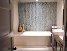 white bathroom wall themes with white bathtub and glass panel also