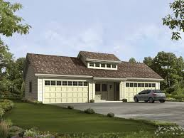 four car garage has center celerestory window on the roof and center double door