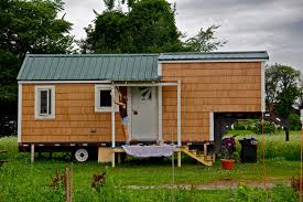 affordable tiny houses. Interesting Affordable Sarah Hastings Paints The Porch Of Her 190squarefoot Tiny House In Hadley To Affordable Tiny Houses T